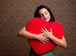 lady holding a heart self love
